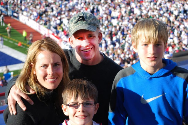 Maj. Joseph Geraci, his wife Caroline and sons Alex, center, and Michael enjoy the game Sunday as the Buffalo Bills took on the New York Jets at Ralph Wilson Stadium.