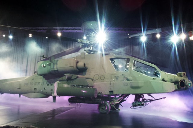 The new Apache Block III helicopter sparkles under bright lights during a ceremony at the Boeing facility in Mesa, Ariz., Nov. 2. The new attack helicopter has a stronger engine, improved avionics, better computer-networking capability and increased maneuverability.