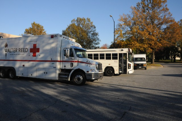 A Walter Reed National Military Medical Center patient evacuation vehicle backs into the patient receiving area of the 779th Aeromedical Staging Facility at Joint Base Andrews in preparations for receiving Wounded Warriors Nov. 04, 2011.