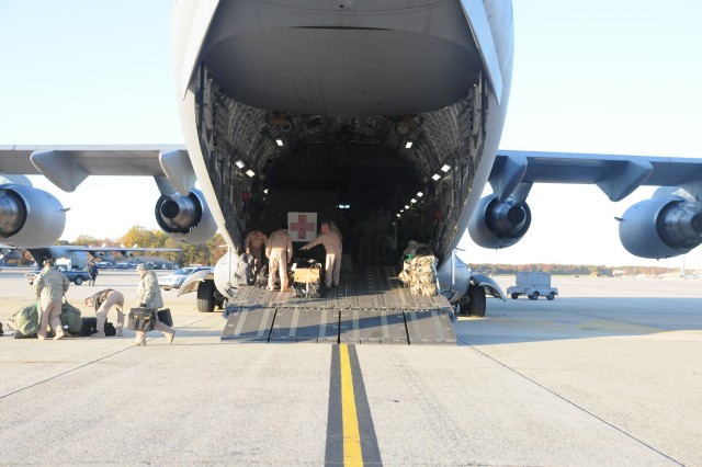 Baggage and equipment are removed from the C-17 Globemaster prior to disembarking passengers and patients on the flight line at Joint Base Andrews, Md.  Nov. 04, 2011.