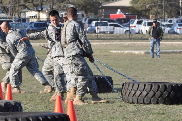 Soldier teams drag a tire weighing more than hundred pounds during the physical fitness challenge Nov. 4, 2011, at Camp Bullis, Texas. The physical fitness challenge was the first event of the inaugural Command Sgt. Maj. Jack L. Clark Jr. Best Medic Competition, dedicated to the 13th command sergeant major of the U.S. Army Medical Command.