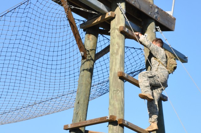 A Soldier climbs an obstacle during the Command Sgt. Maj. Jack L. Clark Jr. Best Medic Competition at Camp Bullis, Texas, Nov. 4, 2011. Each team needed to complete 15 of 19 obstacles as quickly and safely as possible.