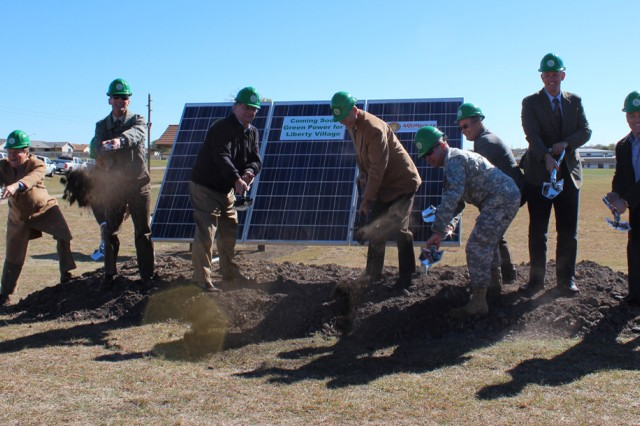 (From left) Pat Wood, Energy Advisor; Brian Dosa, director of Public Works; Richard Bischott, owner of Universal Services Fort Hood, Inc; Donald Grainger, Liberty Village project manager; Garrison Commander Col. Mark Freitag; Albert McNamee, chief, engineering branch, housing; Deputy Garrison Commander Rod Chisholm; and Bill Key, U.S. Army Corps of Engineers, break ground Nov. 3, 2011, on a new solar array field that will be built on a four-acre lot in Liberty Village on Fort Hood, Texas.