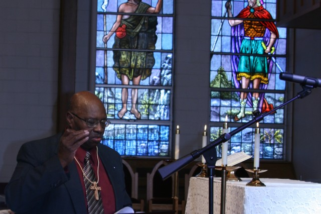 FORT CARSON, Colo. -- Richard Love directs the choir at Soldiers' Memorial Chapel Oct. 23. Love, a retired first sergeant, served at Fort Carson and has been attending Soldiers' Memorial Chapel for 30 years.
