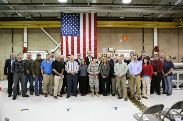 Col. Cheri A. Provancha, Commander, Letterkenny Army Depot and Mr. Scott Jackson, PATRIOT program manager, along with Raytheon and Lower Tier Project Office stand with team members who worked on the first production of the final assembly of the PATRIOT GEM-T missile.