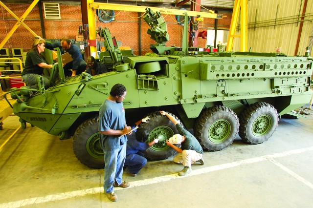 Anniston Army Depot mechanics put the finishing touches on ICV-0003-01, the first Stryker completely reworked at Anniston Army Depot. This pilot program sets the stage for additional Stryker work over the next fiscal year as well as pilot overhauls for many of the remaining Stryker variants.