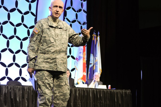 Maj. Gen. Nick Justice, U.S. Army Research, Development and Engineering Command commanding general, leads a panel discussion at a Baltimore convention Nov. 9, 2011.