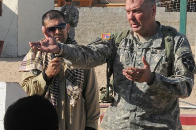 "Col. Barry F. Huggins, commander 2nd Brigade, 2nd Infantry Division (Center) addresses  ""Afghan"" civil leaders at Sorkh Kotal Mezre, Nov. 12, National Training Center, Fort Irwin, Calif.  Col. Huggins was in the town attending the opening of the Sorkh Kotal Mezre Pass."