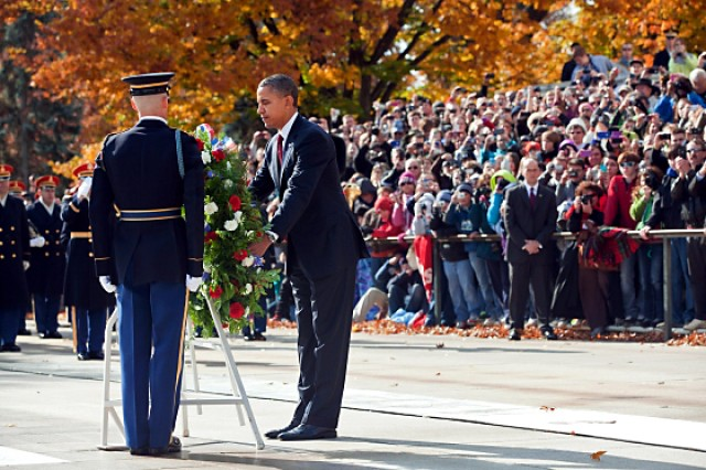 President Barack Obama places a wreath at the Tomb of the Unknowns at Arlington National Cemetery in Arlington, Va., Nov. 11, 2011.
