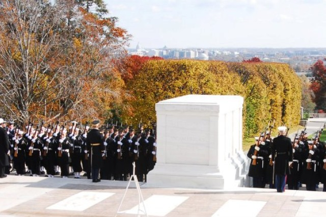 Joint Armed Forces await the arrival of the President of the United States prior to the 2011 Veterans Day wreath laying ceremony at the Tomb of the Unknowns at Arlington National Cemetery, Va.