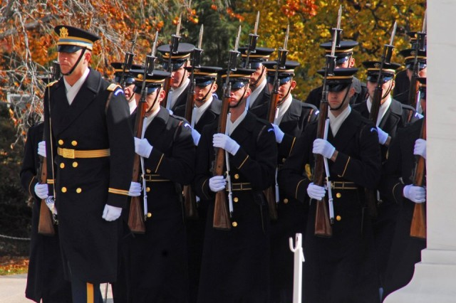 Honor Guard Company, 3d U.S. Infantry Regiment (The Old Guard), await the arrival of the President of the United States prior to the 2011 Veterans Day wreath laying ceremony at the Tomb of the Unknowns at Arlington National Cemetery, Va.