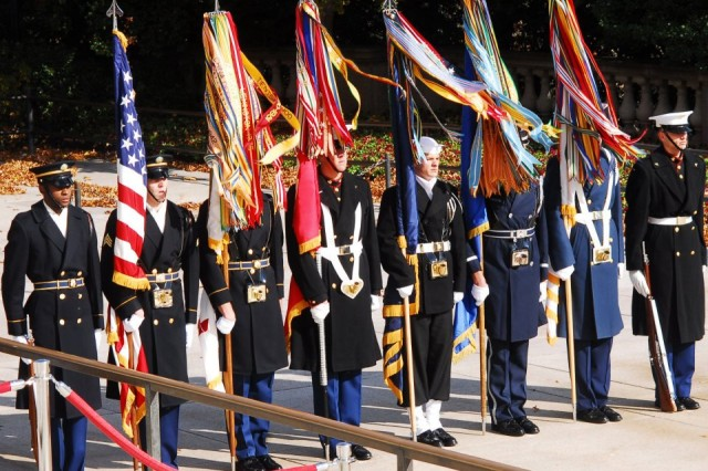 Members of the Continental Color Guard, 3d U.S. Infantry Regiment (The Old Guard), participate in a Joint Armed Forces Color Guard during the 2011 Veterans Day wreath laying ceremony at the Tomb of the Unknowns in Arlington National Cemetery, Va.
