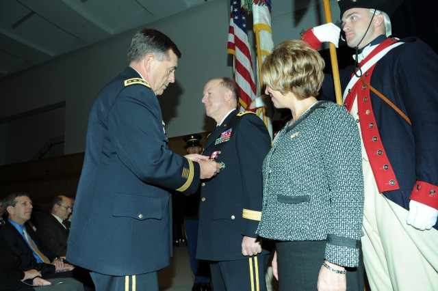 GEN Peter W. Chiarelli awards LTG Mitchell H. Stevenson with the Distinguished Service Medal during his retirement ceremony.  Mrs. Nancy Stevenson looks on.