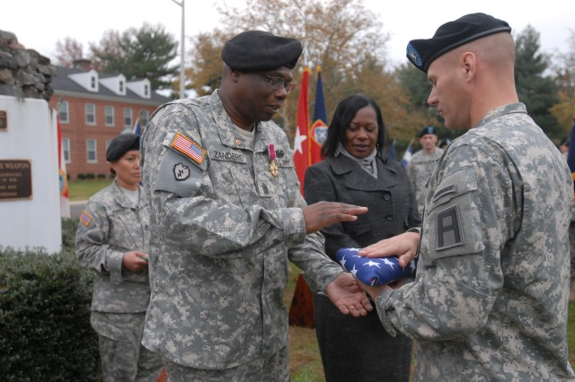 Command Sgt. Maj. Joe Zanders accepted his American flag from Col. Craig A. Osborne, 174th Infantry Brigade commander, during a retirement ceremony held in his honor Nov.4.