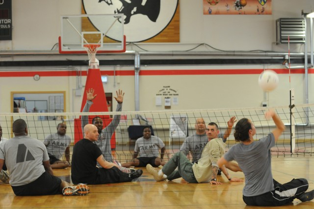 Warrior Transition Battalion-Europe Soldiers, cadre, and Army Morale Welfare and Recreation staff, compete during game of seated volleyball during an adaptive sports clinic at the Kleber Gym and Fitness Center in Kaiserslautern, Germany Nov. 7-10, 2011, led by instructors from the United States Olympic Committee's Paralympic Military Program.