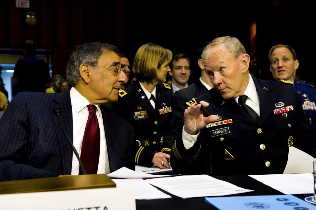 Defense Secretary Leon E. Panetta and Gen. Martin E. Dempsey, chairman of the Joint Chiefs of Staff, speak before giving testimony to the Senate Armed Services Committee, Nov. 15, 2011. Panetta and Dempsey discussed the withdrawal of U.S. troops from Iraq, scheduled to conclude by the end of the year.