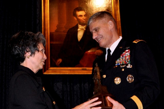 Joan Carter, president, The Union League of Philadelphia, presents the 2011 Abraham Lincoln Award to Gen. David M. Rodriguez, commanding general, U.S. Army Forces Command, Nov. 11, 2011, at the Union League of Philadelphia's Salute to Veterans Luncheon. Rodriguez spoke to the more than 400 League members and guests - including more than 40 veterans of World War II, thanking the veterans for their service, and discussing the complex challenges and many threats facing the U.S., today.