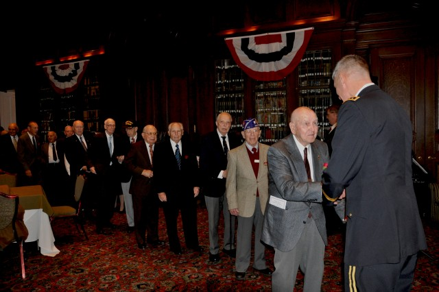"World War II Veterans queue up to greet General David M. Rodriguez, commanding general, U.S. Army Forces Command, at a private reception after a Veterans Day Luncheon, Nov. 11, 2011, at the Union League of Philadelphia.  Rodriguez was presented with the 2011 Abraham Lincoln award during the event. Forty World War II veterans were in attendance at the League's ""Salute to America's World War II Heroes"" Luncheon."
