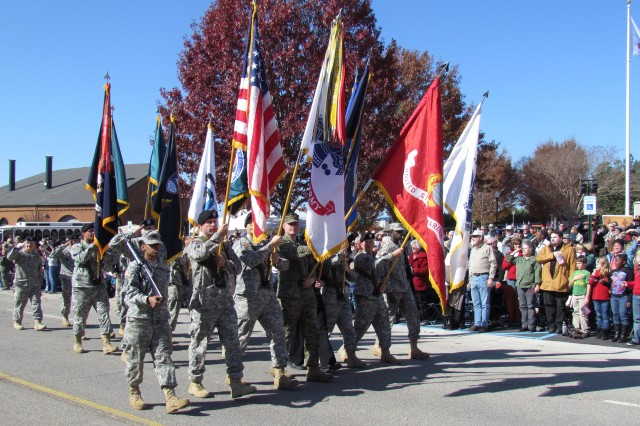 """The Redstone Arsenal color guard leads the Veterans Day parade on the streets in downtown Huntsville on Friday. Marching right behind them is a new entry for 2011 """" the command sergeants major of Redstone Arsenal."""