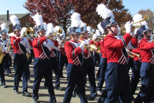 The Huntsville High School band performs for the crowds as the Veterans Day parade's closing band. There were six bands in the parade.