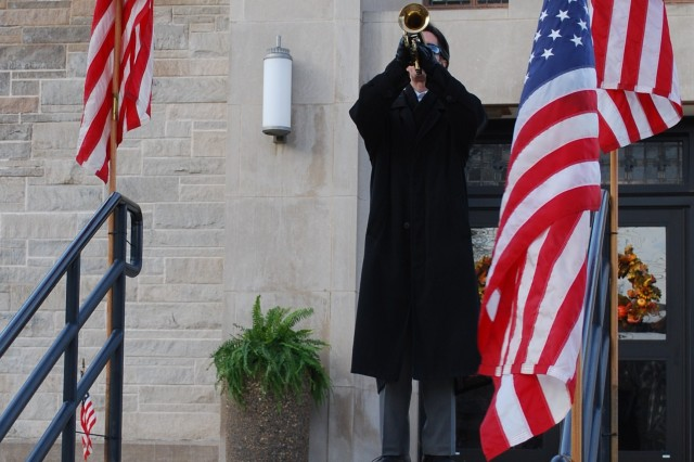 """A lone bugler performs """"Taps"""" during Our Lady of Grace Catholic Academy's Veterans Day observance in East Moline, Ill.  (U.S. Army photo by Capt. Grady Adkins)"""