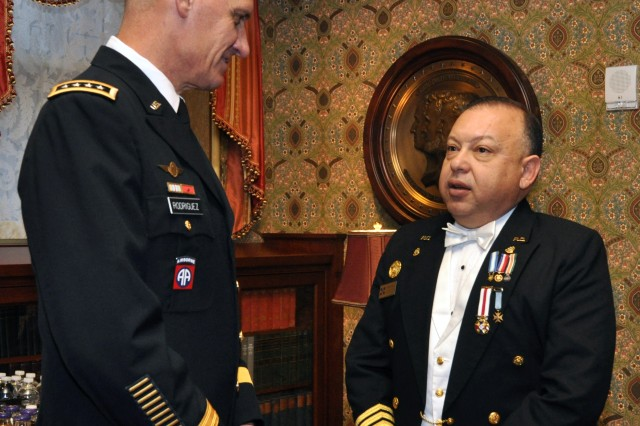 Gen. David M. Rodriguez, commanding general, U.S. Army Forces Command talks with Vice Adm. Homero Luis Lajara Sola, vice minister of the Armed Forces of the Dominican Republic, Nov. 11, 2011, at the Union League of Philadelphia.