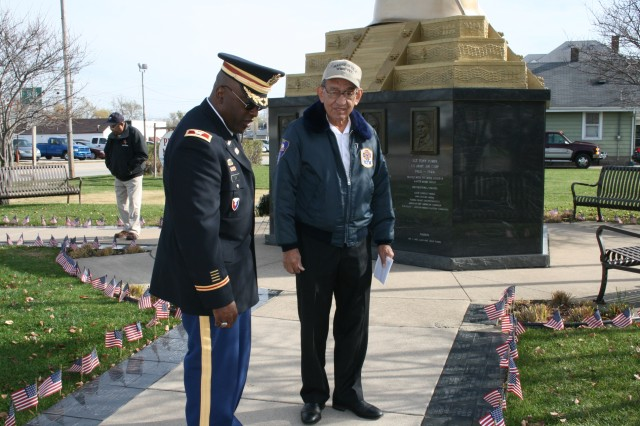 Col. Richard Dix, Army Sustainment chief of staff, learns more about the Hero Street Memorial from Frank Soliz following the Veterans Day ceremony Silvis, Ill., Nov. 12. (U.S. Army photo by Jackie Hoggins, ASC Public Affairs)