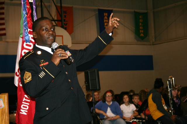 1st Sgt. Eric Evans, Army Sustainment Command, gestures during his presentation to students at the Jr. High School during the Veterans Day ceremony in Silvis, Ill., Nov. 11 (U.S. Army Photo by Jackie Hoggins, ASC Public Affairs)