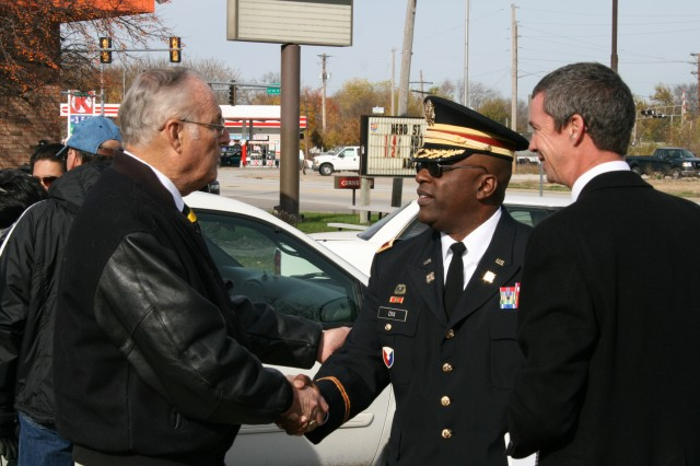 Col. Richard Dix, Army Sustainment chief of staff, thanks master of ceremonies and veteran Ray Hamilton following the Hero Street Veterans Day ceremony in Silvis, Ill., Nov 12. (U.S. Army photo by Jackie Hoggins, ASC Public Affairs)