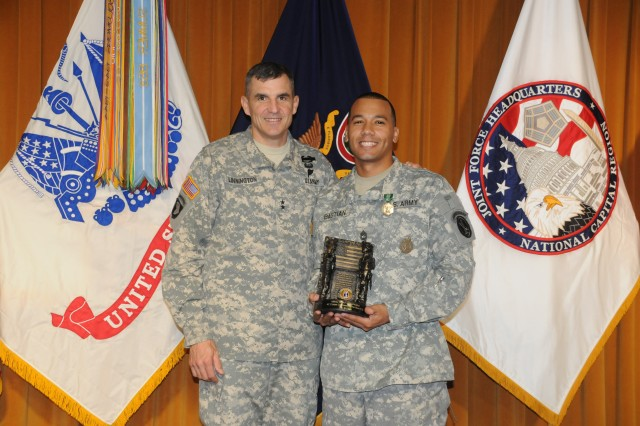 Maj. Gen. Michael S. Linnington, commanding general of the Joint Force Headquarters - National Capital Region and the U.S. Army Military District of Washington (JFHQ-NCR/MDW), presents the Fiscal Year 2012 JFHQ-NCR/MDW Active Component Career Counselor of the Year award to Sgt. 1st. Class William P. Bastian, Jr., 3D Infantry Regiment (The Old Guard) during an award ceremony at Fort McNair, Nov. 10, 2011.  Bastian was also presented an Army Commendation Medal by Linnington for his service.