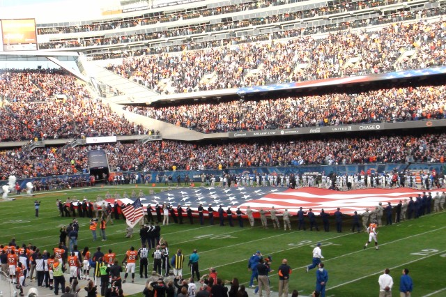 All military services were represented at Soldier Field on Veteran's Day when service members participated in a flag unfurling just prior to the start of the Chicago Bears Detroit Lions football game. U.S. Army Photo: OCPA Midwest (Sgt. 1st Class Ernest White)