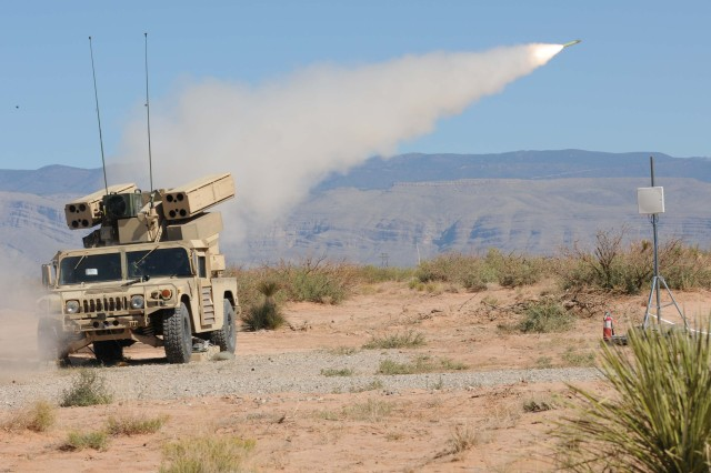 Soldiers from 2nd Battalion, 263rd Air Defense Artillery, South Carolina National Guard, send a stinger missile downrange from the Humvee-mounted Avenger missile system at Range 91 near Oro Grande, N.M., Oct. 23, 2011.