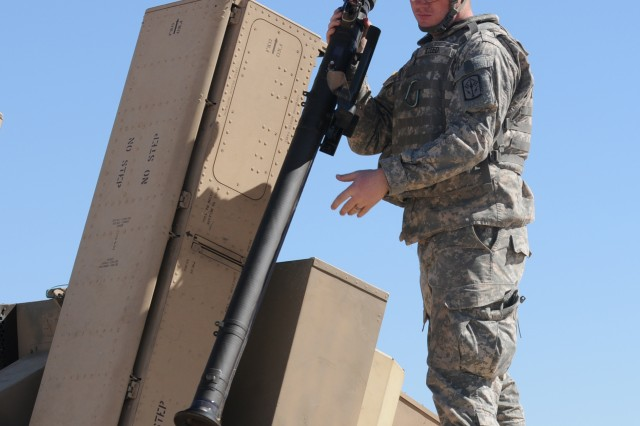 Spc. Nicholas Steed, 2nd Battalion, 174th Air Defense Artillery, Ohio Army National Guard, prepares to reload a stinger missile in the Humvee- mounted Avenger missile system at Range 91 near Oro Grande, N.M., Oct 23, 2011.