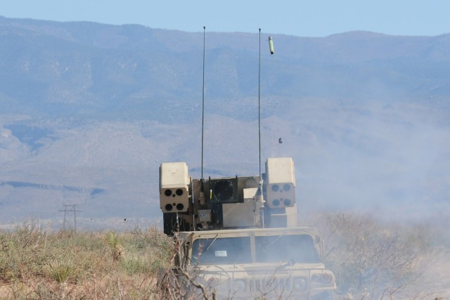 Soldiers from 2nd Battalion, 263rd Air Defense Artillery, South Carolina Army National Guard, drive a Humvee with a mounted Avenger missile system at Range 91 near Oro Grande, N.M., Oct. 23, 2011.  The Guardsmen are preparing for their mission to protect the Nation Capital Region.