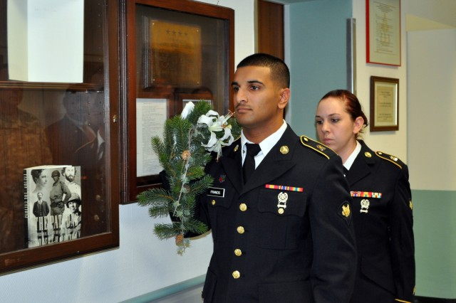 Heidelberg Health Center Honor Guard members Spcs. Justin Francis and Megan Davies prepare to place a garland above the encased plaque honoring Gen. George S. Patton outside of the room where he passed away in December 1945. The event was part of the annual Patton Remembrance Ceremony at Nachrichten Kaserne Nov. 9.
