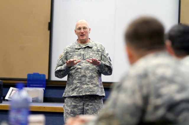 Gen. Robert Cone, commanding general of the U.S. Army Training and Doctrine Command, speaks to noncommissioned officers, warrant officers and company-grade officers at the Army Profession Junior Leader Forum, held at Fort Sill, Okla., Nov. 15-18, 2011, as part of TRADOC's Unified Quest program.