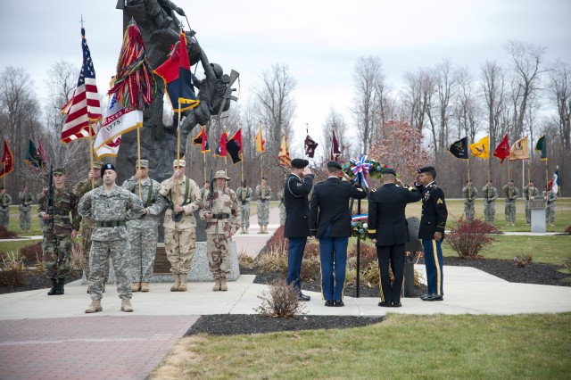 Brig. Gen. Harry E. Miller Jr., special assistant to the 10th Mountain Division (LI) commander, and Command Sgt. Maj. Kevin D. Sharkey, acting 10th Mountain Division and Fort Drum command sergeant major, place a wreath at the Military Mountaineers Monument at Fort Drum's Memorial Park as a sign of respect and appreciation for the sacrifices that all Soldiers, sailors, airmen and Marines have made for the nation.
