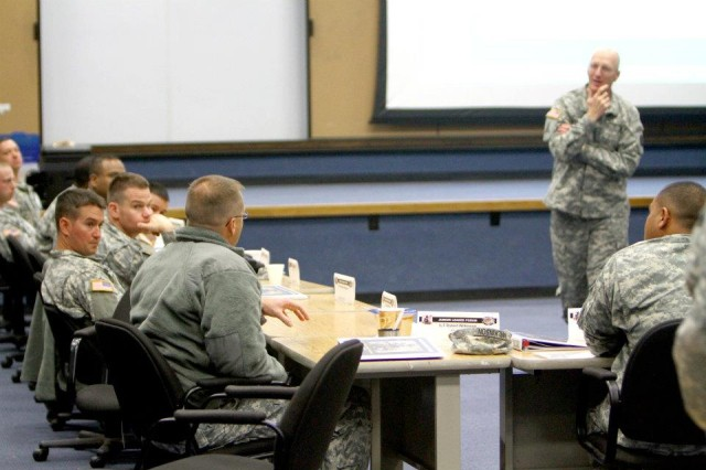 Gen. Robert Cone, commanding general of the U.S. Army Training and Doctrine Command, listens to noncommissioned officers, warrant officers and company-grade officers at the Army Profession Junior Leader Forum, held at Fort Sill, Okla., Nov. 15-18, 2011, as part of TRADOC's Unified Quest program.