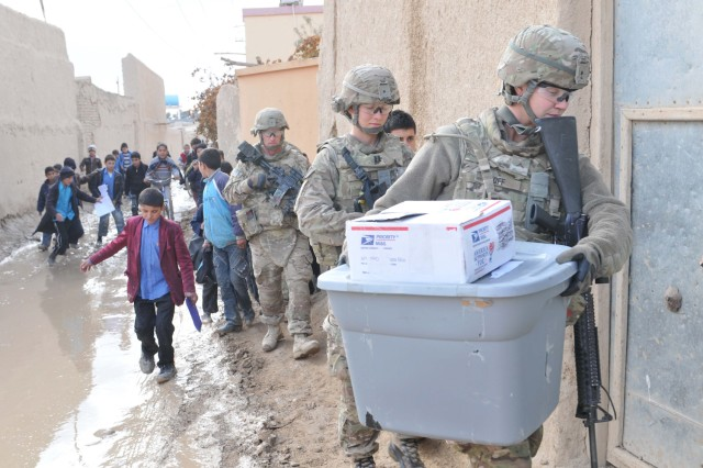 Havoc Soldiers bring excitement to pupils during school aid drop