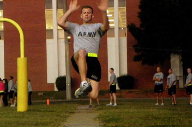 Sgt. Zachary Jarrell, 164th Theater Airfield Operations Group, takes part in the long-jump portion of recent tryouts for the German Armed Forces Proficiency Badge. Jarrell was one of 22 Fort Rucker, Ala., Soldiers to qualify for the badge.