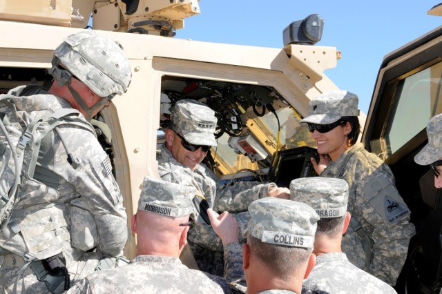 Vice Chief of Staff of the Army Gen. Peter W. Chiarelli interacts with Soldiers from the 2nd Brigade Combat Team, 1st Armored Division, during a visit to White Sands Missile Range, N.M., Nov. 15, 2011, as part of the Network Integration Evaluation. Chiarelli interviewed several Soldier operators on the functionality of new communications equipment.