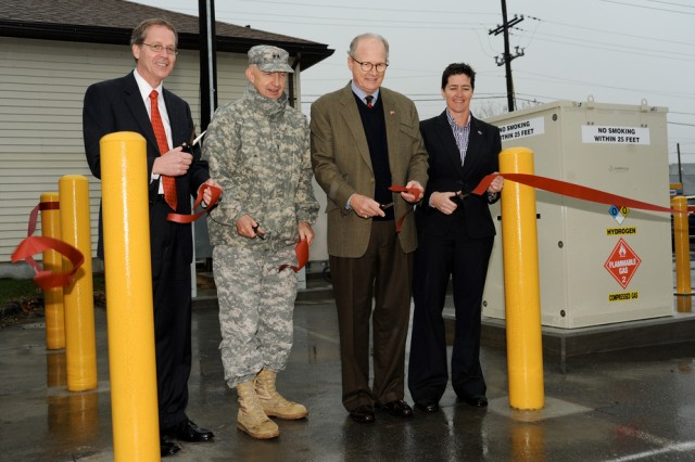 Officials cut the ribbon Nov. 16 to unveil Aberdeen Proving Ground's hydrogen fuel cells at the Building Operations Control Center (Building 325). From left, Rick Farmer, deputy program manager with the Department of Energy's Office of Energy Efficiency and Renewable Energy; Maj. Gen. Nick Justice, APG senior installation commander; Sam Logan, chief executive officer of Logan Energy; and Adele Ratcliff, director of the Office of Secretary of Defense Manufacturing Technology.