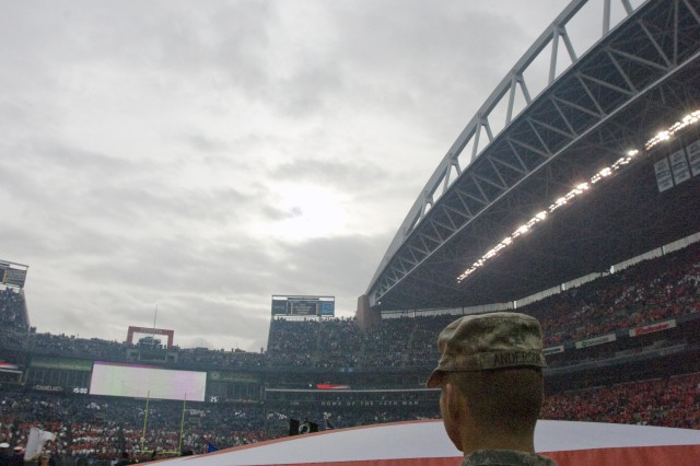 A C-17 Globemaster III performs a flyover during a pregame Military  Appreciation Day ceremony at CenturyLink Field.