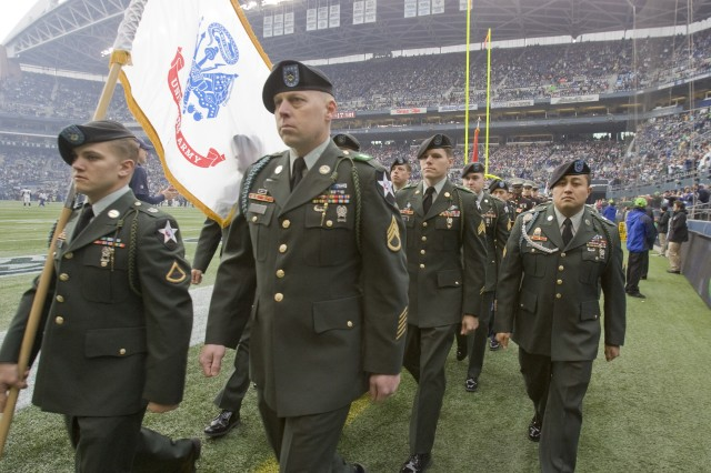 Soldiers from the 1-23 Inf. march off the field during Military Appreciation Day honoring servicemembers before the Seahawks game against Baltimore at CenturyLink Field.