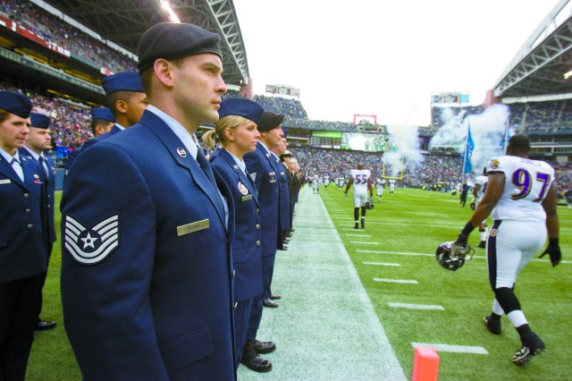 JBLM Airmen stand at attention as players make their way onto the field during Military Appreciation Day Nov. 13 at CenturyLink Field in Seattle.