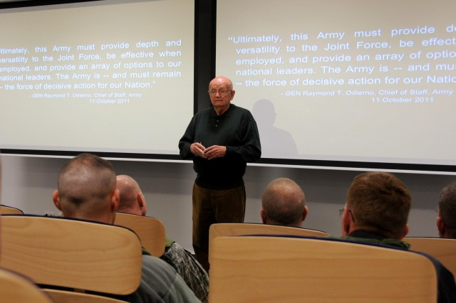 Retired Army Gen. Gordon R. Sullivan, the president and chief operating officer of the Association of the United States Army (AUSA) and the 32nd Chief of Staff of the Army, conducts leadership development training to the KFOR Staff, including observers, controllers and trainers while visiting the Joint Multinational Readiness Center in Hohenfels, Germany, Nov. 16. (U.S. Army photo by Spc. Gemma Iglesias)