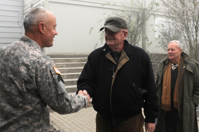 Retired Army Gen. Gordon R. Sullivan, the president and chief operating officer of the Association of the United States Army (AUSA) and the 32nd Chief of Staff of the Army is greeted by U.S. Army Col. Jeffery Martindale, Commander of the Joint Multinational Readiness Center (JMRC) in Hohenfels, Germany Nov. 16, 2011. Sullivan attended Kosovo Force training, and event with the 157th Maneuver Enhancement Brigade, a Wisconsin Army National Guard Unit comprised of Soldier from more than 13 states.   (U.S. Army photo by Spc. Gemma Iglesias)