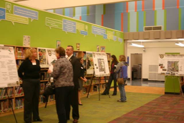 Paul Fluck, program manager of the Directorate of Public Works Restoration Program, speaks to community members at a public hearing held Nov. 9 at the elementary school.