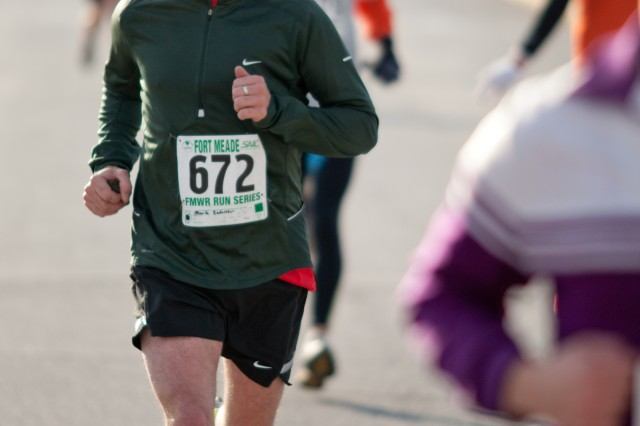 Mark Zahner runs alongside more than 200 competitors who gathered Saturday at Murphy Field House for the annual Turkey Trot 5K/Fun Walk, the sixth race in the Fort Meade Run Series.