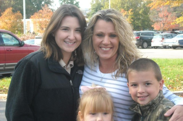 Daughters Allyson and Riley Drake (left) and son Austin Drake (right) gather with their mother, Dana Drake, for a Family photo. The Drake Family was named the 2011 U.S. Military District of Washington Family of the Year for their outstanding volunteer work in the community. (Courtesy photo)